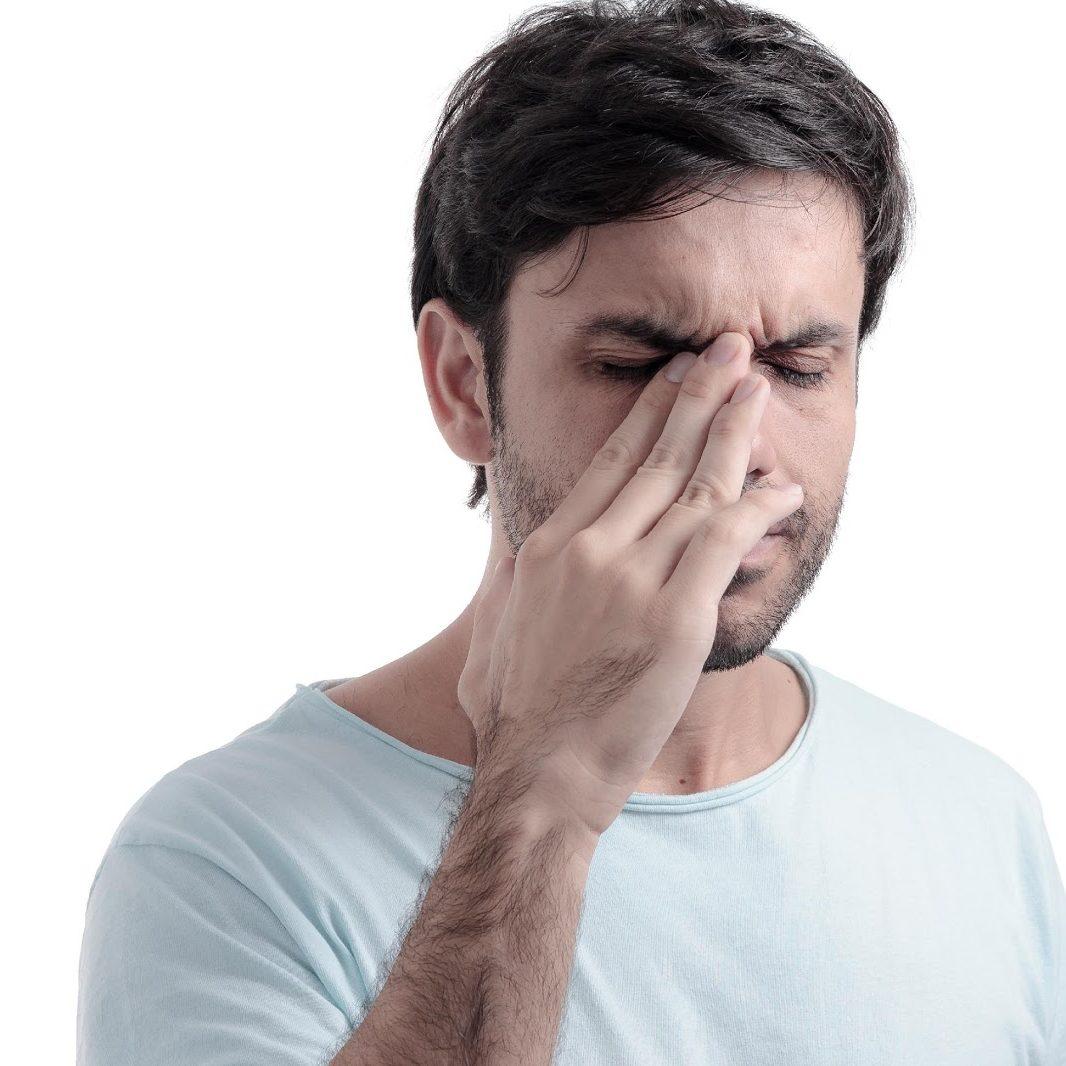 man with sinusitis headache